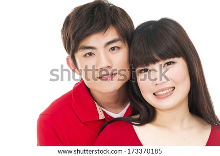 Portrait of a beautiful young couple posing in studio - stock photo
