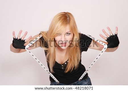 Portrait of a beautiful young female rock singer - stock photo