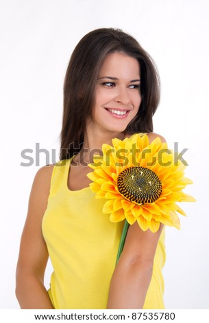 portrait of a beautiful young female with a sunflower