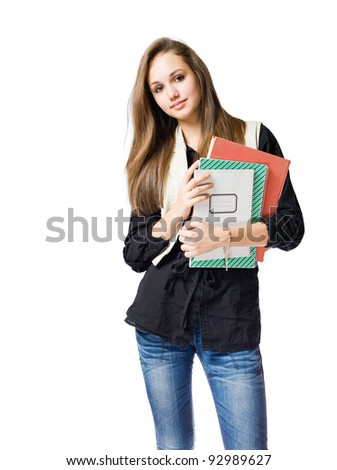 Portrait of a beautiful young friendly brunette student girl. - stock photo