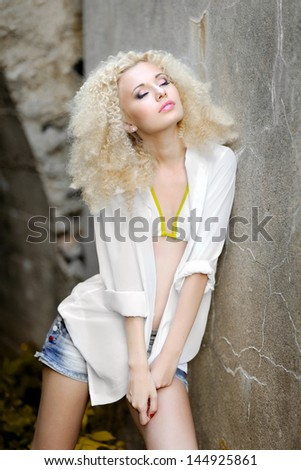 portrait of a beautiful young girl in a bikini - stock photo