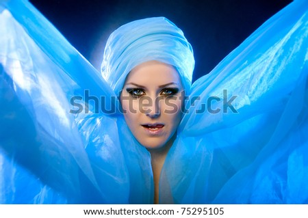 portrait of a beautiful young girl in a blue veil with beautiful eyes