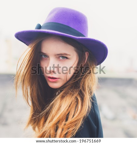 portrait of a beautiful young girl in a hat - stock photo