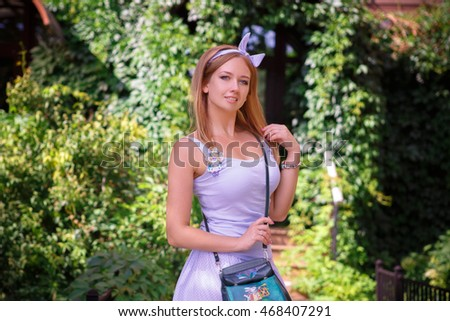 Portrait of a beautiful young girl in the Park skirt