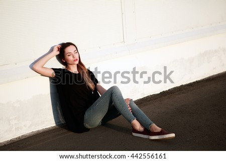 Portrait of a beautiful young girl in the Parking lot