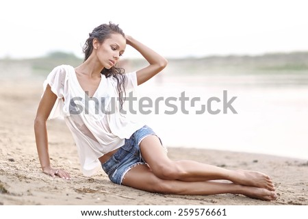portrait of a beautiful young girl  in wet shirt - stock photo