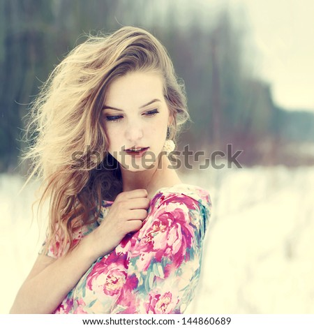 Portrait of a beautiful young girl in winter - stock photo