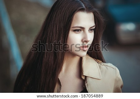 portrait of a beautiful young girl on street. outdoor photoshoot - stock photo
