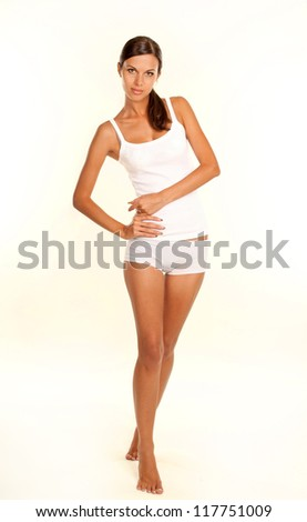 portrait of a beautiful young girl over white background - stock photo