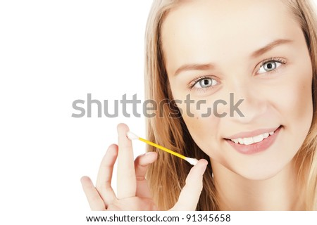 portrait of a beautiful young girl, skin care, facial care, cotton swabs, a towel on his head, isolated on white