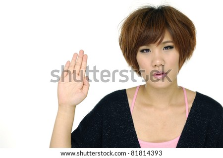 Portrait of a beautiful young girl waving hand, isolated over white background - stock photo