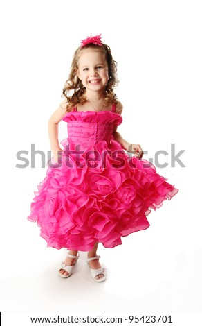 Portrait of a beautiful young girl wearing a fancy pink party gown dress, isolated on white in studio