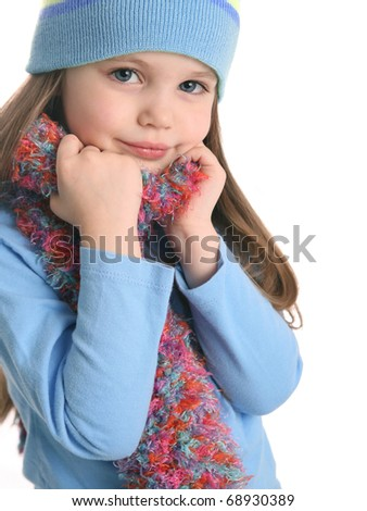 Portrait of a beautiful young girl wearing a hand knit scarf and winter hat isolated on white - stock photo