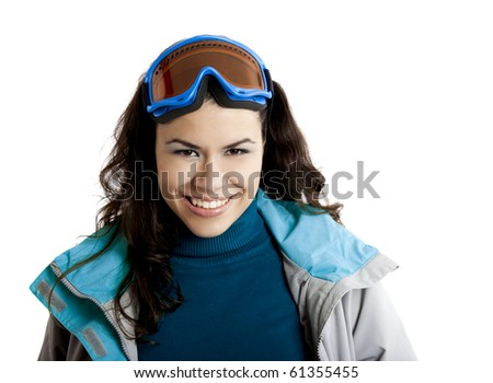 Portrait of a beautiful young girl wearing a winter coat and snow glasses