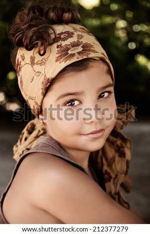 Portrait of a beautiful young girl wearing headscarf - stock photo