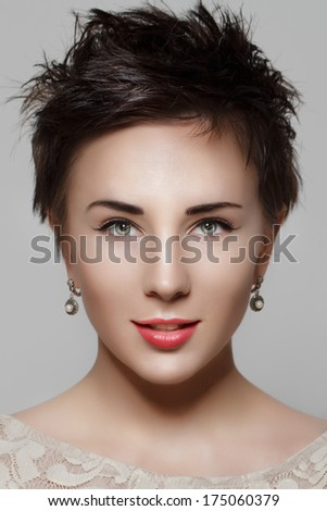 Portrait of a beautiful young girl with short hair. Beauty photo - stock photo
