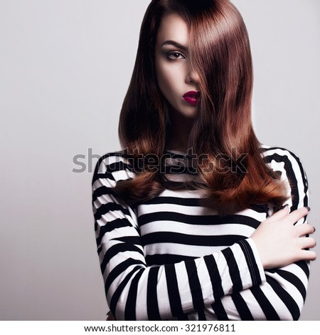 Portrait of a beautiful young girl with smooth hair - stock photo
