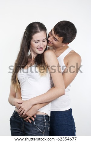Portrait of a beautiful young happy kissing couple