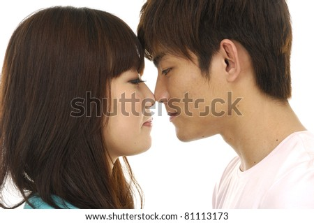 Portrait of a beautiful young happy kissing couple - stock photo