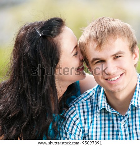 Portrait of a beautiful young happy smiling couple - green park outdoor - stock photo