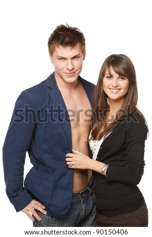 Portrait of a beautiful young happy smiling couple - isolated on white background - stock photo