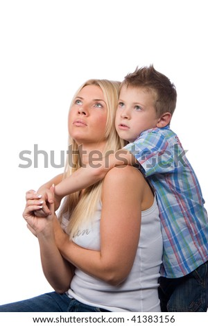 portrait of a beautiful young mother and a little sad boy