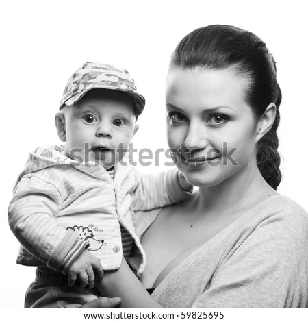 Portrait of a beautiful young mother with sweet  baby boy - stock photo