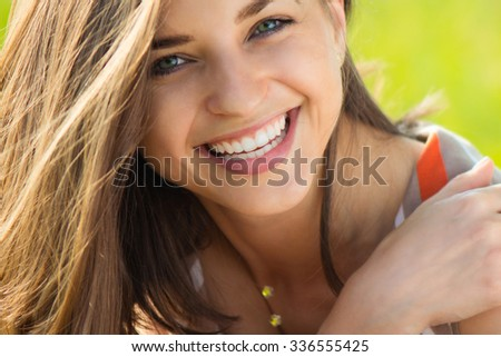 Portrait of a beautiful young smiling girl