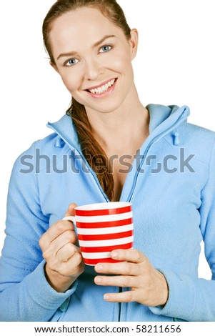 Portrait of a beautiful young smiling woman holding a cup of coffee or tea. Isolated over white.