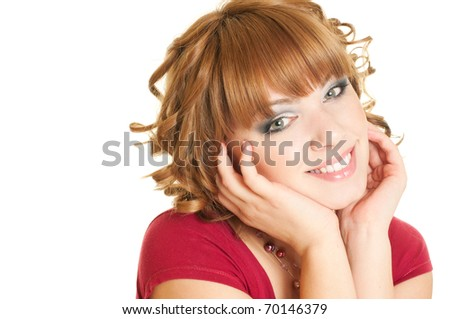 Portrait of a beautiful young smiling woman touching her face - stock photo