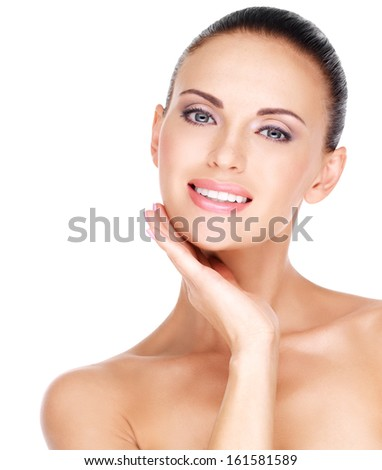 Portrait of a beautiful young smiling woman with healthy fresh skin of the face - isolated on white