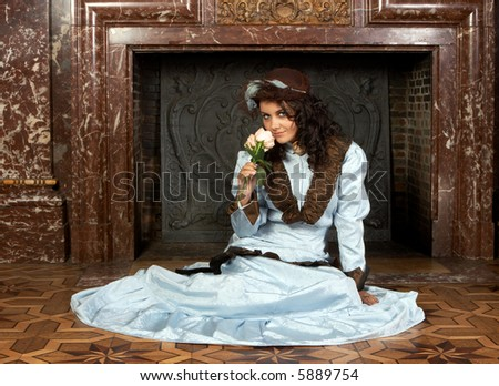 """Portrait of a beautiful young victorian lady in front of a castle fireplace. Shot in the antique castle """"Den Brandt"""" in Antwerp, Belgium (with signed property release for the Castle interiors). - stock photo"""