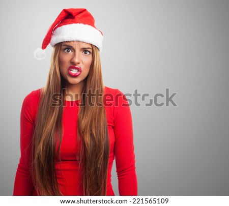 portrait of a beautiful young woman at Christmas with angry gesture - stock photo
