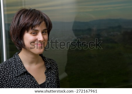 Portrait of a beautiful young woman at home - stock photo