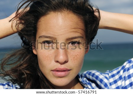 portrait of a beautiful young woman at the sea - stock photo
