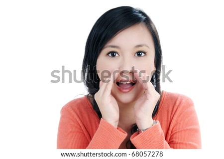 Portrait of a beautiful young woman cheering over white background.