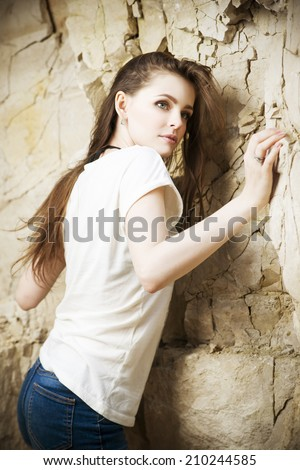 Portrait of a beautiful young woman climber. Girl climbs a rock - stock photo