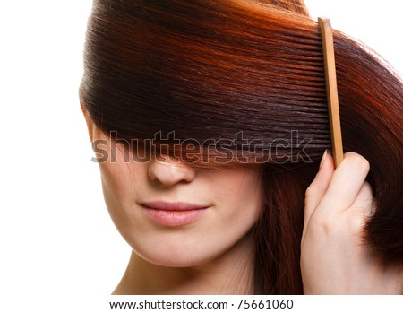 portrait of a beautiful young woman comb wonderful hair