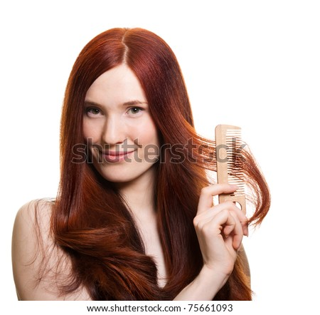 portrait of a beautiful young woman comb wonderful hair - stock photo
