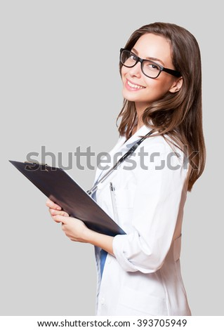 Portrait of a beautiful young woman doctor with stethoscope. - stock photo