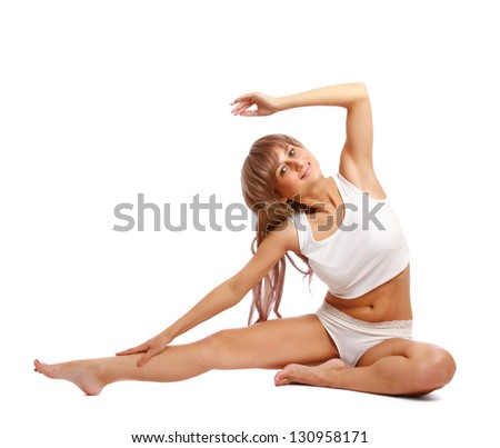 Portrait of a beautiful young woman doing yoga exericise against white background - stock photo