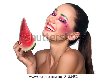 Portrait of a beautiful young woman eating watermelon. Isolated over white background. soft focus - stock photo