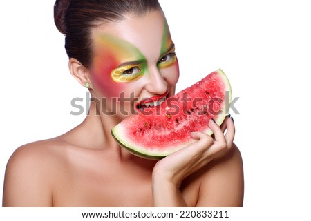 Portrait of a beautiful young woman eating watermelon. Isolated over white background. soft focus