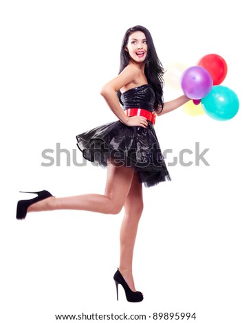 portrait of a beautiful young  woman holding balloons , isolated against white background