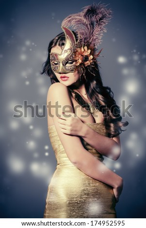 Portrait of a beautiful young woman in a carnival mask. Vintage - stock photo