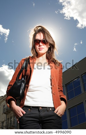 Portrait of a beautiful young woman in a city - stock photo