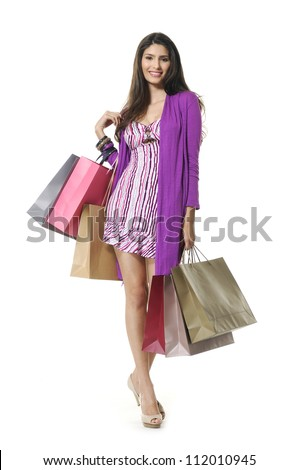 portrait of a beautiful young woman, in a  holding in her hands a few shopping bags - stock photo