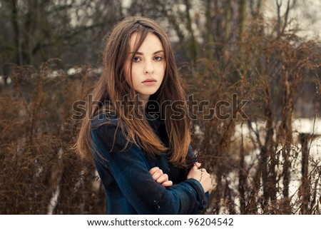 portrait of a beautiful young woman in a park in spring - stock photo