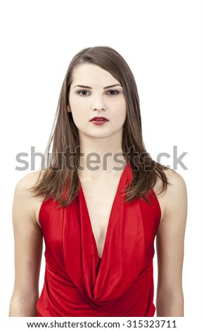 Portrait of a beautiful young woman in a red dress against a white background. - stock photo