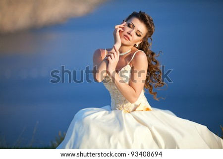 portrait of a beautiful young woman in a wedding dress - stock photo